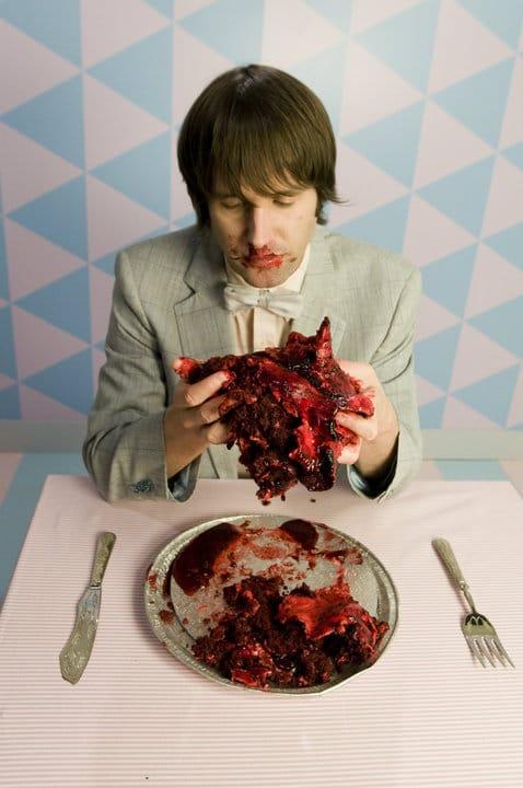 Holding Valentines Bleeding Heart Cake