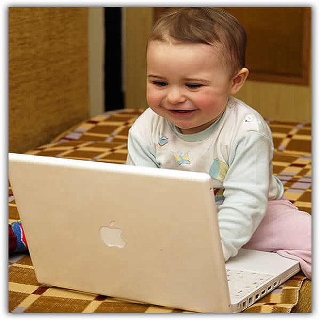 Toddler Playing On Macbook
