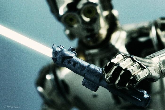 C-3PO Robot Holding Lightsaber