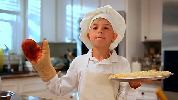 Kids Making Pizza In Kitchen