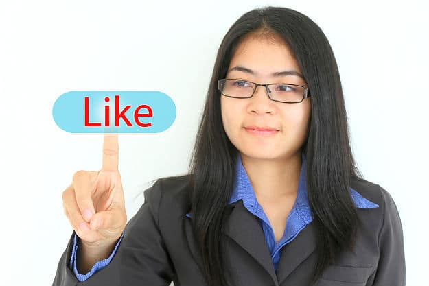 girl clicking on like button