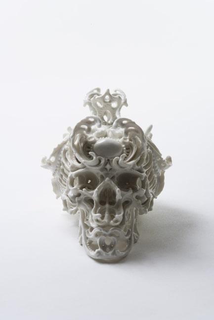 Intricate Porcelain Skull Sculpture Design