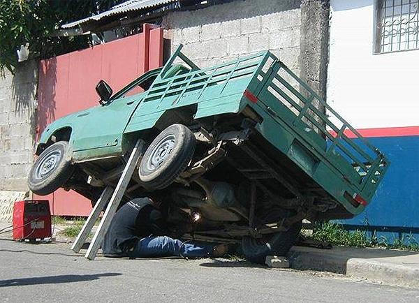 Dangerous Fixing Pickup Truck
