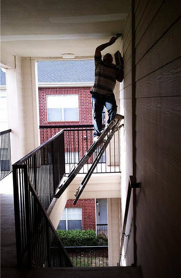Dangerous Painting Job With Ladder