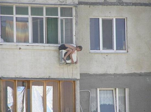 Hanging Onto Air Conditioner Outside