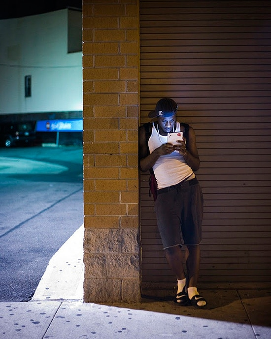 People With iPhones At Night