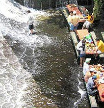Whoa! A Creative Restaurant Designed At The Base Of A Waterfall
