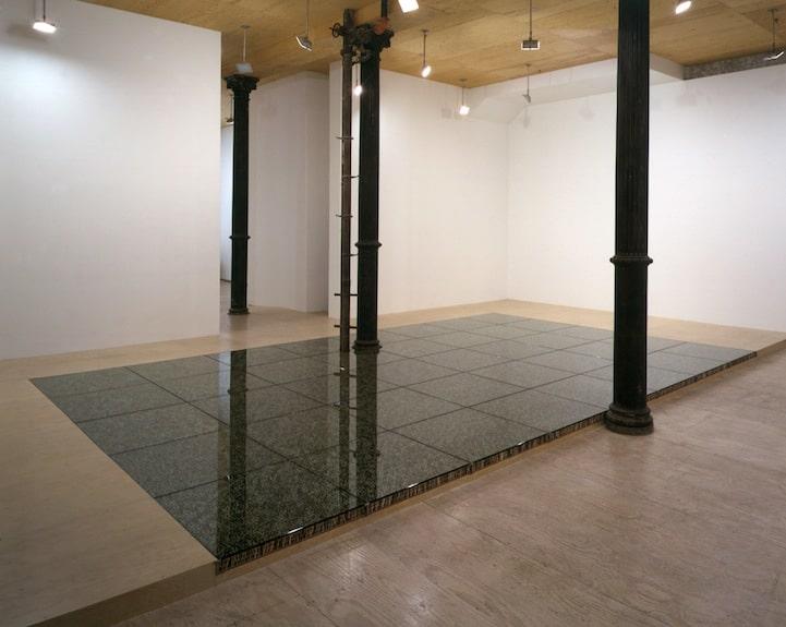 figurines-holding-up-glass-floor