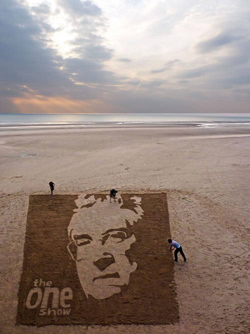 male face beach art
