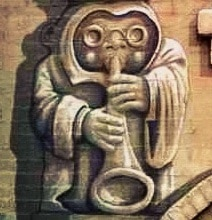 Street Art: New York Gargoyle Building Sings The Blues