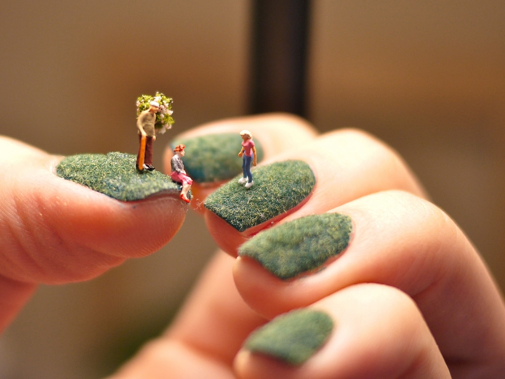 A World Of Miniature People Living On Green Fingernails