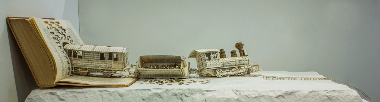 Book Sculpture Illustrates OCD With A Derailed Typography Train
