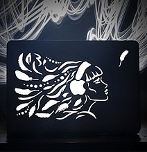 Turn Your MacBook Backlight Into A Laser Etched Unique Work Of Art