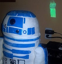 R2-D2 Cake Plays The Leia Hologram As A Movie Projection On The Wall
