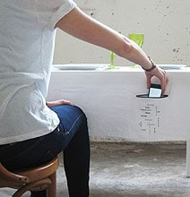 Tablecloth With Smartphone Holder Reminds Us To Mind Our Table Manners