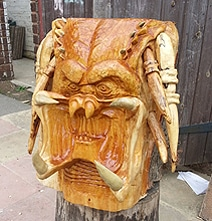 An Extraterrestrial Predator Head Carved From A Humongous Tree Stump