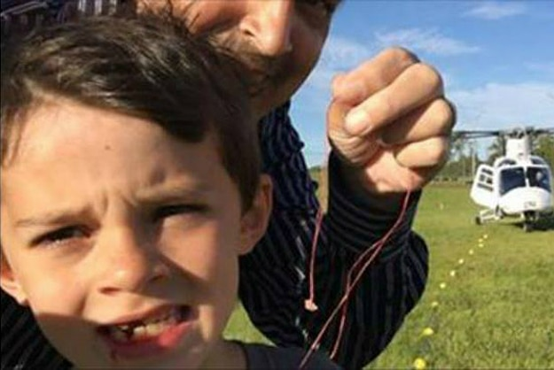Dad Uses His Helicopter To Remove His Son's Loose Tooth