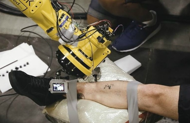 Two Guys Turned This Indsutrial Robot Into A Tattoo Master