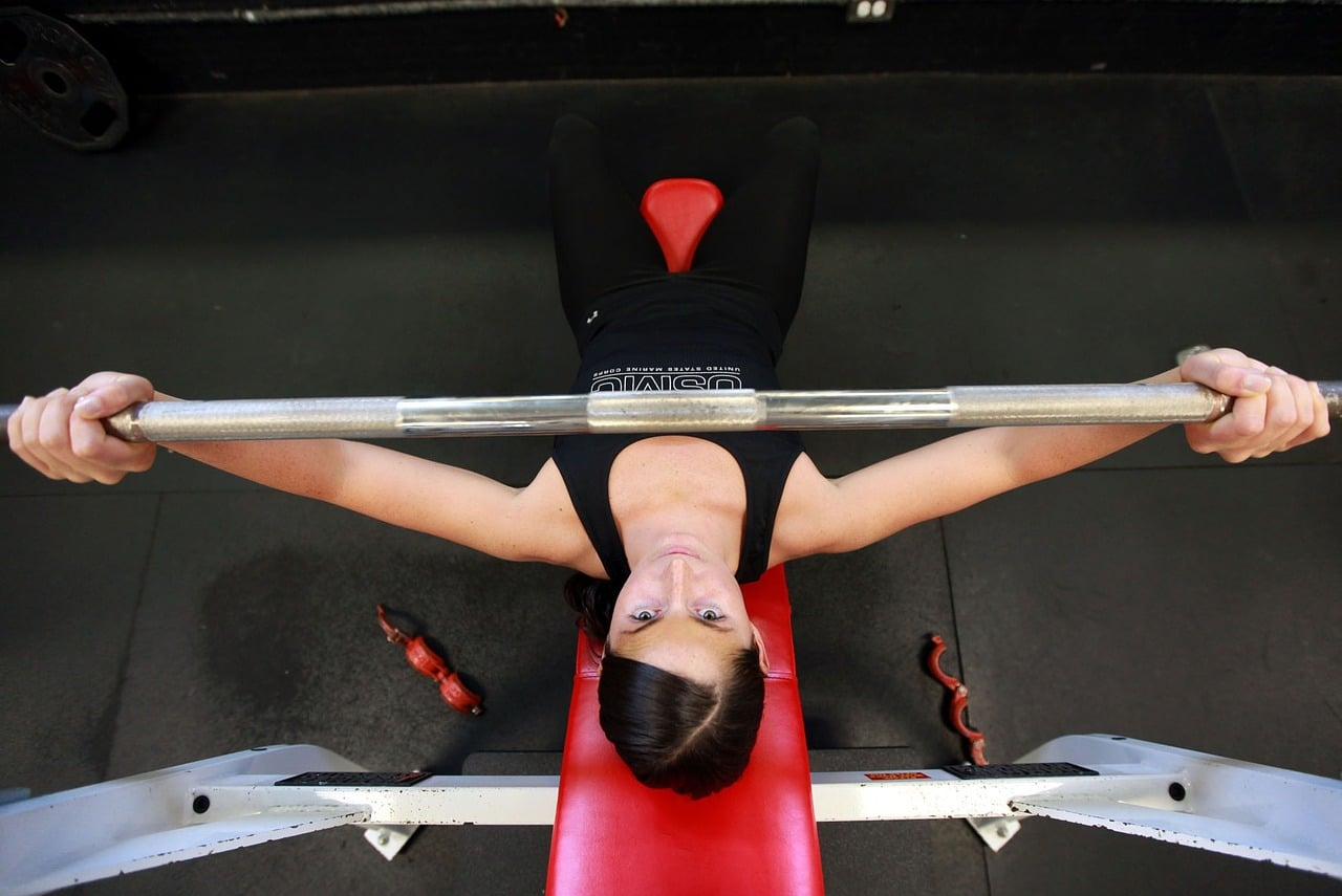 7 Reasons Woman Lifting Weights Header Image